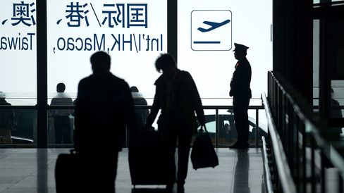 A policeman stands guard at the entrance of Beijing's international airport.