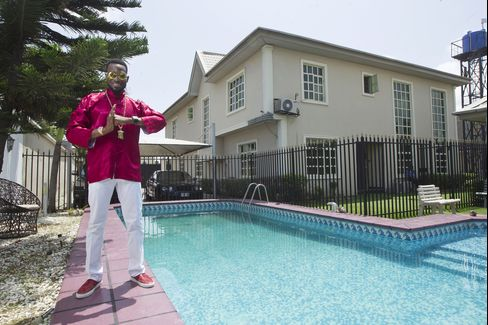 D'banj by the pool at home
