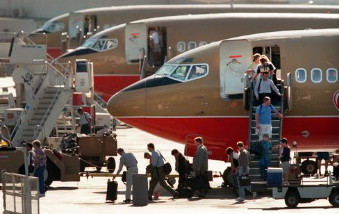 Passengers disembark from Southwest Airlines flights parked at Burbank Airport during the late after