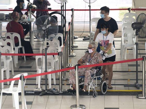 Hong Kong Risks Global Status as Singapore Opens Up to World
