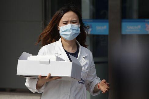A hospital worker at a quarantine tent