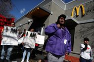 Fast food workers and union members protest on Feb. 12 outside of a McDonald's restaurant in Oakland, California.