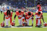 Kansas City Chiefs players kneel before the game on Sept. 24.