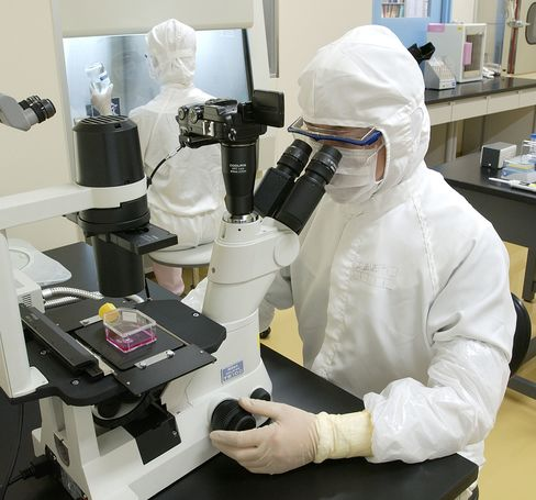 Scientists work at the Japan Tissue Engineering laboratory.