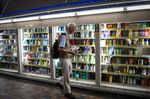 A customer holds cleaning products while shopping at a drug store in the Nakano district of Tokyo Japan.