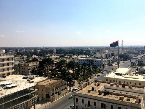 A Libyan national flag flies over Tripoli Street in Misrata, Libya.