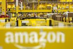 The Amazon logo sits on a cart at an Amazon.com fulfillment center.