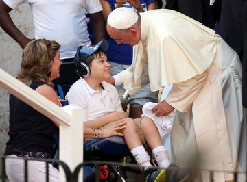 Pope francis greets a disabled boy as leaves following visit to the father felix varela cultural center on sept. 20, 2015 in havana, cuba.
