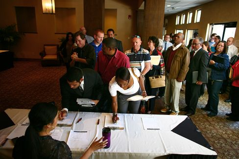 Job Seekers Sign In At A Job Fair