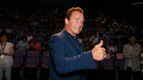 Arnold Schwarzenegger signals at the event screening of the Terminator Genisys on August 18, 2015 in Shanghai, China.