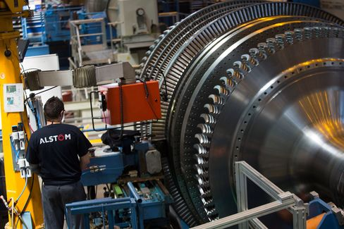 An Alstom employee works a turbine unit under construction inside Alstom SA's power-generation plant in Belfort, France, on Tuesday, June 24, 2014.