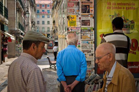Portuguese Rating Cut, Greek Wrangling Fuel Bond Contagion