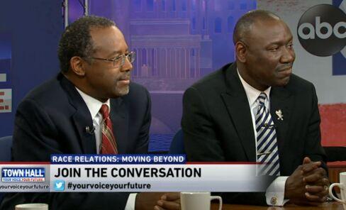Ben Carson (left) appears on Washington's NewsChannel 8 on Jan. 19, 2015.