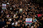 Protesters hold up an image of Qassem Soleimani, an Iranian commander, during a demonstration following the U.S. airstrike in Iraq which killed him, in Tehran, Iran,.
