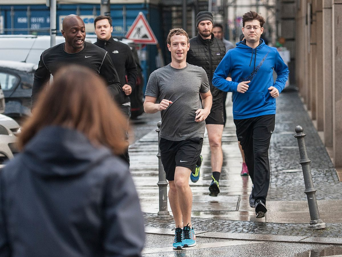 Image result for zuckerberg running with security guards