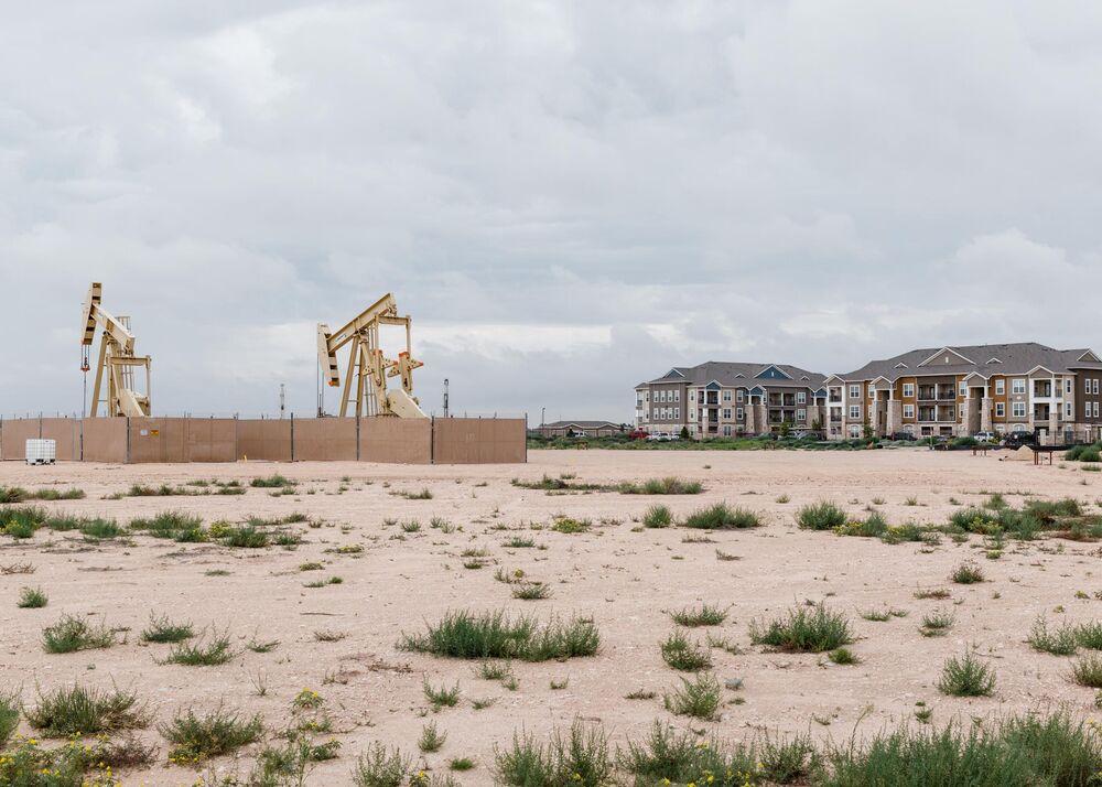 Oil pump jacks adjacent to an apartment complex in Midland, Texas.