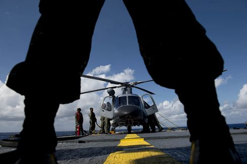 A Philippine Navy officer stands in front of a helicopter during a bilateral maritime exercise between the Philippine Navy and U.S. Navy.