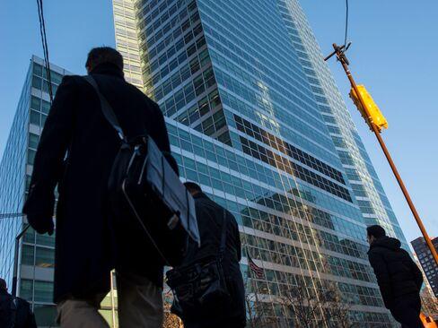 People walk past the Goldman Sachs headquarters in New York.