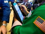 Trading On The Floor Of The NYSE As Stocks Fluctuate Ahead of Earnings