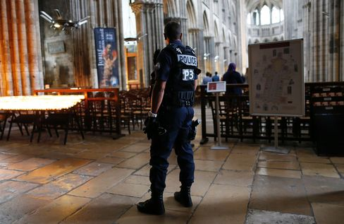 Police stand guard at the Rouen Cathedral.