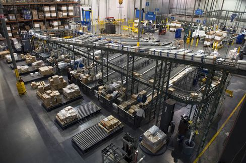 UPS Lowers 2013 Earnings Forecast, Citing Slowing Economy
