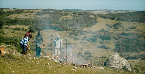 Francis Mallmann roasts chickens over a fire in Chef's Table.