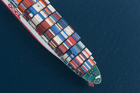 An Orient Overseas Container Line (OOCL) container ship waits to unload cargo in this aerial photograph taken above the Port of Los Angeles.