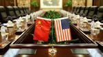 Flags of the US and China.