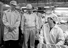 Cook visiting the iPhone production line at Foxconn's Zhengzhou technology park in March 2012