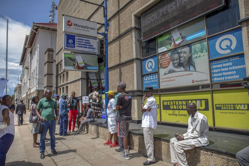 People Queue Outside A Foreign Currency Exchange And Money Transfer Outlet In Harare On Jan