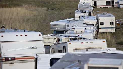 Recreational vehicles sit in a row in Alexander.