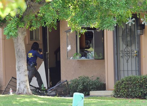 The FBI searches the San Bernardino shooter's home in Redlands, Calif. on Dec. 3, 2015.