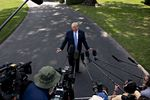 U.S. President Donald Trump speaks to members of the media before boarding Marine One on the South Lawn of the White House in Washington, D.C.