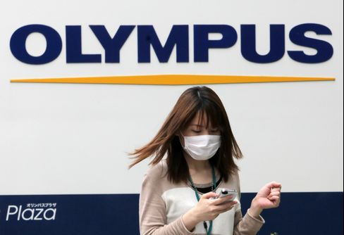 Olympus Gains After Raising Net Income Forecast