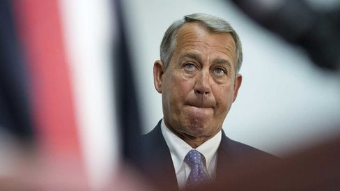 U.S. House Speaker John Boehner, a Republican from Ohio, listens during a news conference after a House Republican Conference meeting at the U.S. Capitol Building in Washington, D.C., U.S., on Tuesday, Dec. 2, 2014.