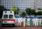 Medical personnel gather at the Guang'an Sport Center to test people who visited or live near Xinfadi Market in Beijing on June 14.