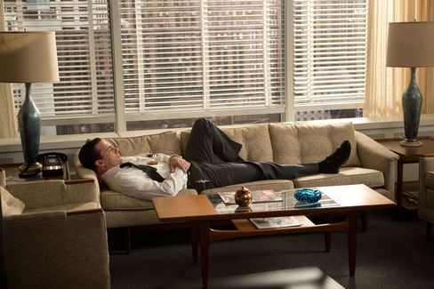 In season 6, Don Draper (played by Jon Hamm) stretches out on his mid-century modern sofa between a pair of blue glazed ceramic lamps—the most expensive props bought outright.