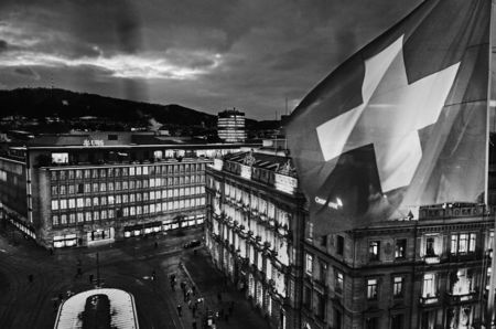 The Swiss flag flies on the roof of luxury hotel Savoy Baur en Ville, overlooking Paradeplatz.