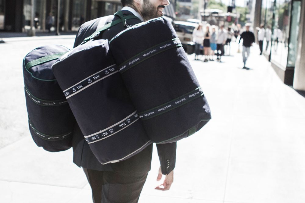 2fa0c5c9be After 23 Years, the Banker Bag Grows Up and Gives Back - Bloomberg