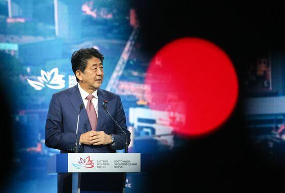 Japan's Longest Serving Premier Faces 2020 Hobbled by Scandals