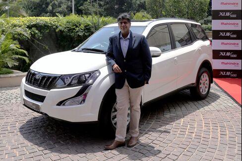 Vijay Nakara of Mahindra and Mahindra with an SUV in Bangalore