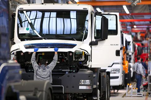 An employee works on a cab unit for a MAN TGS truck.