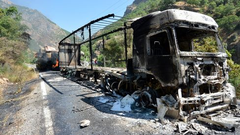 Debris from a trailer and an excavator supposedly set on fire by PKK members sits in Tunceli, Turkey, on August 1, 2015.