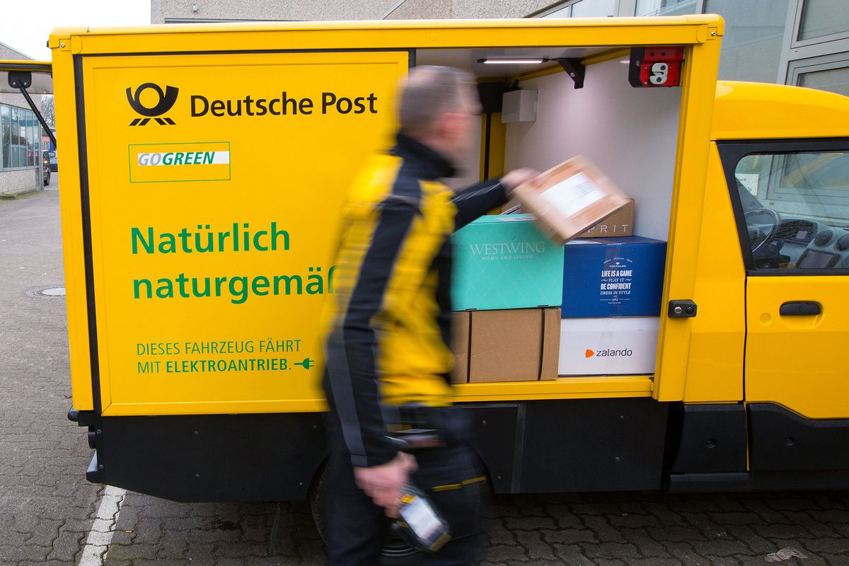 even germany s post office is building an electric car bloomberg. Black Bedroom Furniture Sets. Home Design Ideas