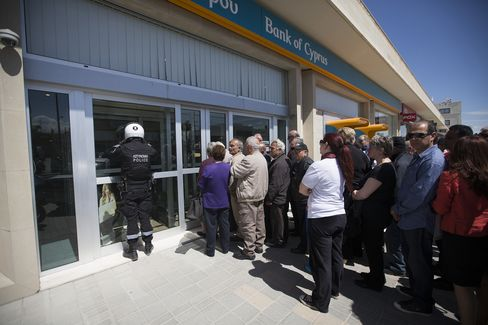 Cyprus's Banks Open After Two Weeks as Controls Curb Panic