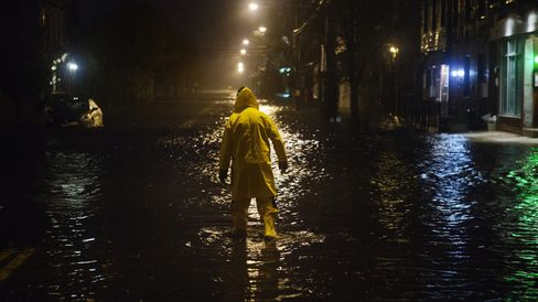 A resident wades through a flooded street in Red Hook during Hurricane Sandy.