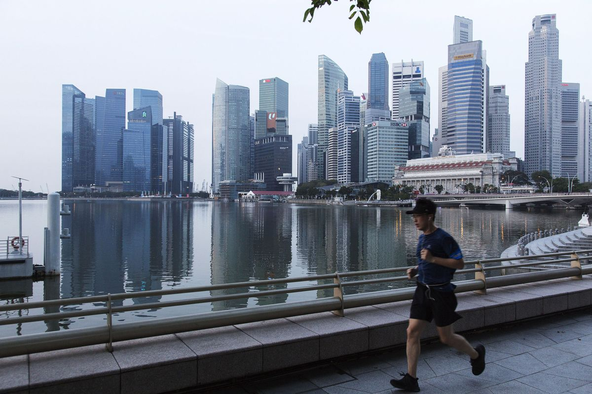 Slowing Singapore Economy Drives Profit Drop as Trade War Bites