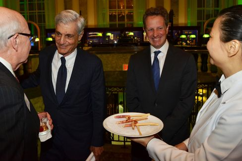 Robert Rubin and Tim Geithner flank an offering of Cipriani breadsticks wrapped in prosciutto.