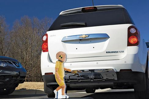 A foam cutout of a child is used in a rear end sensor test.