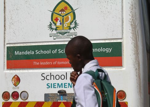 A Student Walks Past a Branded Bus